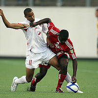 Orlando City Lions Forward Maxwell Griffin (11) and Henry Kalungi (25) fight for the ball during a United Soccer League Pro soccer match between the Richmond Kickers and the Orlando City Lions at the Florida Citrus Bowl on May 25, 2011 in Orlando, Florida.  (AP Photo/Alex Menendez)