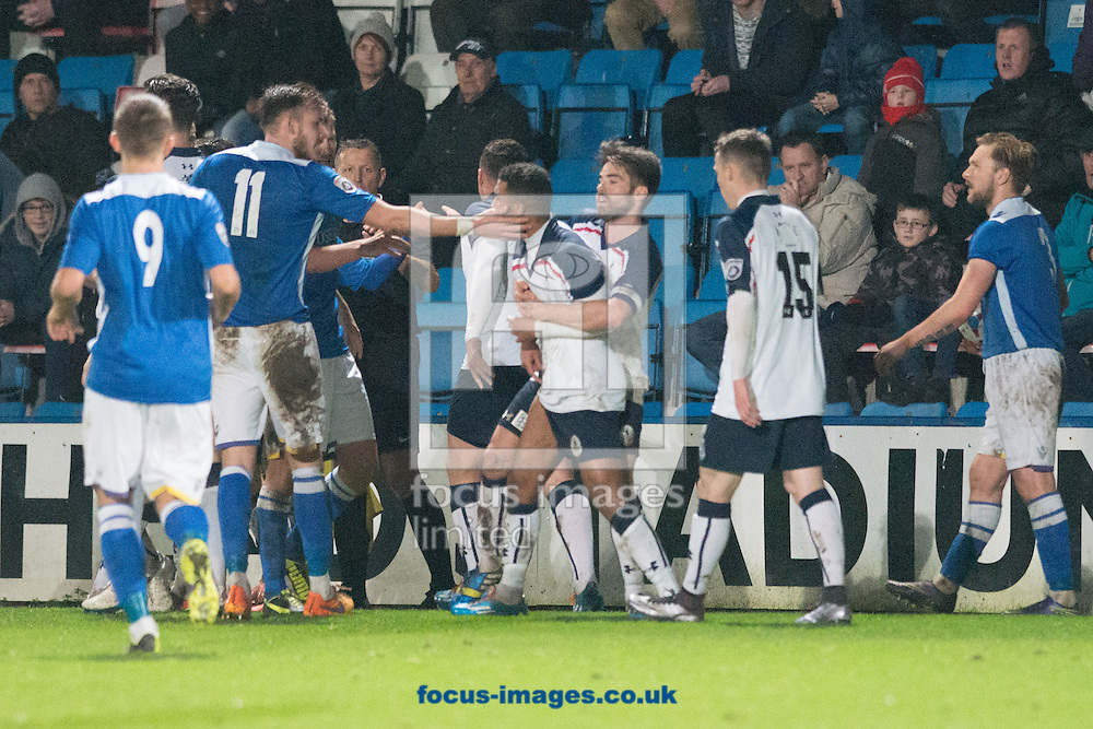 A.F.C. Telford United players clash with Lowestoft Town players following a bad challenge during the National League North match at New Bucks Head, Telford<br /> Picture by Matt Wilkinson/Focus Images Ltd 07814 960751<br /> 19/12/2015