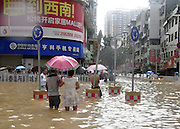 SONGTAO MIAO AUTONOMOUS COUNTY, CHINA - JULY 15: (CHINA OUT)<br /> <br /> Floods hit china<br /> <br /> Residents walk in flood caused by a rainstorm on July 15, 2015 in Songtao Miao Autonomous County, Tongren City, Guizhou Province of China. A rainstorm hit Songtao Miao Autonomous County from Tuesday night to Wednesday morning with a 293.8-millimeter rainfall causing 1 person dead of lightning and affecting about 135,000 people. <br /> ©Exclusivepix Media