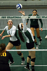 28 October 2016:  Colleen Rynne sets for Maisy Bowden during an NCAA womens division 3 Volleyball match between the DePauw Tigers and the Illinois Wesleyan Titans in Shirk Center, Bloomington IL