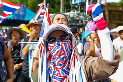 © Licensed to London News Pictures. 16/05/2014. A PDRC protestor cheers during a rally outside Parliament in Bangkok Thailand where key senators were holding a meeting on May 16, 2014.  Photo credit : Asanka Brendon Ratnayake/LNP