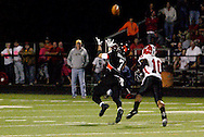Senior Tony Peters (10) persues senior Trent Koehler (7) as he catches a Justin Weaver pass as the Wayne Warriors play the Beavercreek High School Beavers at the Frank Zink Field in Beavercreek, Friday, October 7, 2011.
