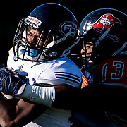 Fullerton College wide receiver, DeAndre McNeal, gets tackled by Orange Coast College&rsquo;s running back, Aundre Carter, during a football game in  Lebard Stadium at Orange Coast College on November, 5, 2016. Fullerton College won the game 34-14. <br /> <br /> Carolyn Rogers/ SSA