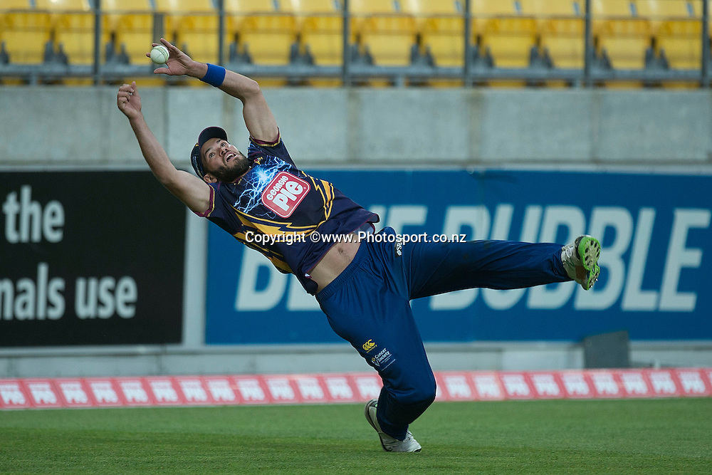 Roald Badenhorst of the Volts jumps to atempt a catch during the Georgie Pie Super Smash Volts v Knights cricket match at the Westpac Stadium in Wellington on Sunday the 23rd of November 2014. Photo by Marty Melville/www.Photosport.co.nz