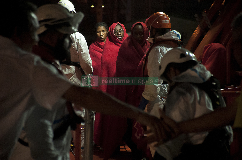 October 3, 2018 - Malaga, Spain - Migrants women stand on a rescue boat as they wait to disembark after their arrival at the Port of Malaga. Spain's Maritime Rescue service rescued 90 migrants aboard two dinghies at the Mediterranean Sea and brought them to Malaga Harbour, where they were assisted by the Spanish Red Cross. (Credit Image: © Jesus Merida/SOPA Images via ZUMA Wire)