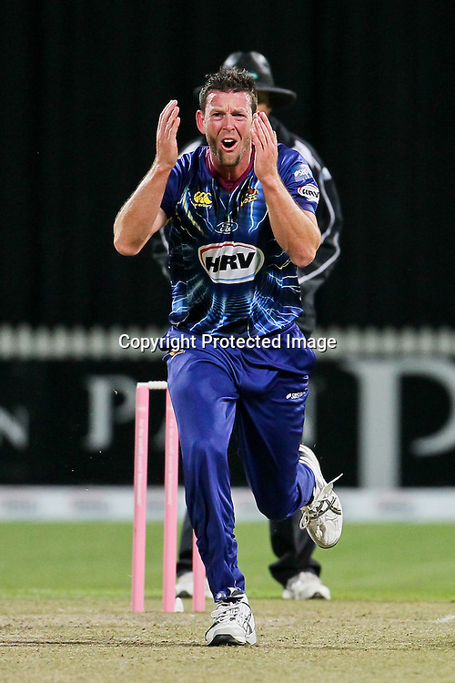 Otago Volt's Ian Butler reacts to almost bowling Northern Knights's Anton Devich during the HRV Cup - Northern Knights v Otago Volts at Seddon Park, Hamilton on Friday 14 December 2012.  Photo: Bruce Lim / Photosport.co.nz