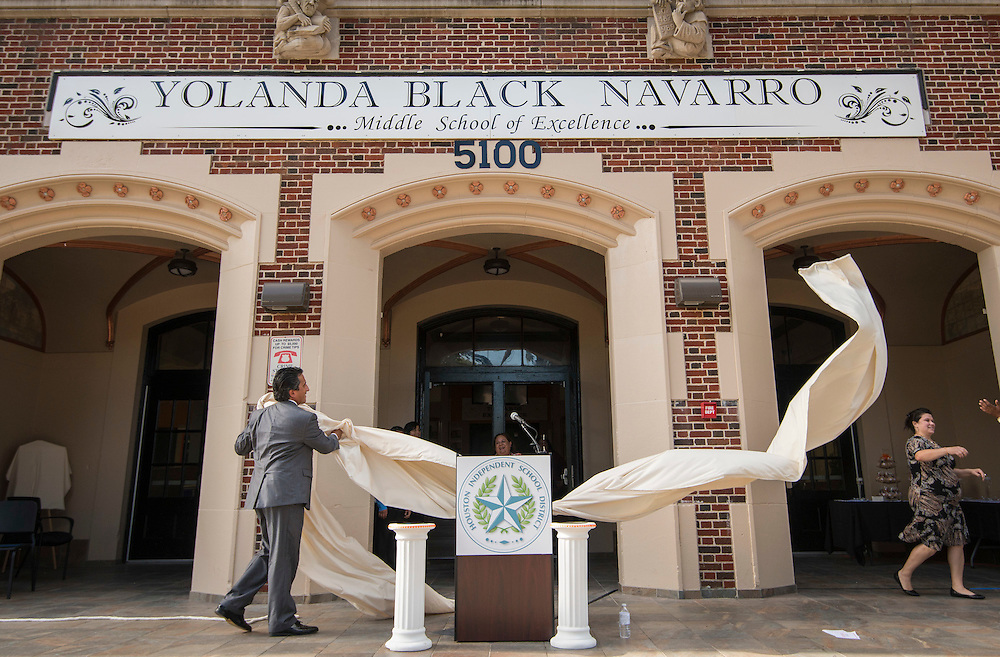 Christian Navarro unveils the new name during a ceremony to rename Jackson Middle School to Navarro Middle School in honor of Yolanda Black Navarro, October 5, 2016.