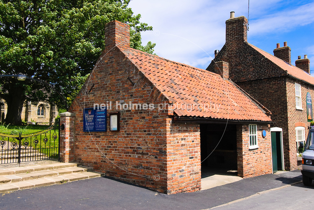 Lund Village, East Yorkshire. The village blacksmith's shop, now the bus shelter. The fire and chimney breast can be seen as a permanent reminder of the blacksmith who once worked in the village.