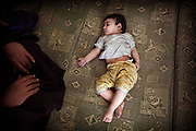 May 10, 2012-Damascus , Syria: inside a house in al -Qazzaz neighborhood , 6 month old baby , survived from a massive terrorist explosion targeted  al-Qazaz intersection at the southern ring-road in Damascus during the morning rush hour on Thursday, killing at least 55 people and wounding 372, the majority are civilians .