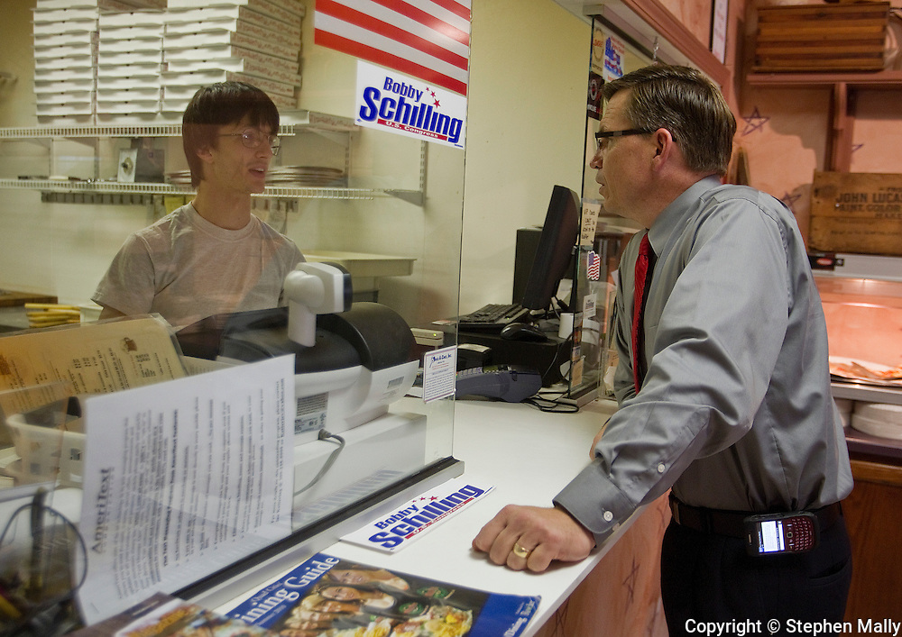 Congressman-elect Robert Schilling (right) (IL-17) talks with his son, Aaron Schilling (left), at the counter of his pizza shop, Saint Giuseppe's Heavenly Pizza, in Moline, Illinois on Tuesday November 9, 2010.