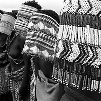 IPMG0371 South Africa, Kestel, 1999: .Female BaSotho initiates are led in traditional song in Kestel during a traditional ceremony. Once they are finished, the masks are burnt and the girls may enter society as women..Photograph by Greg Marinovich/South Photographs