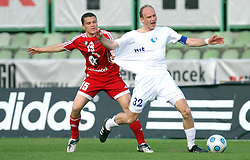 Darijan Matic of Interblock vs Milan Osterc of Hit Gorica at 28th Round of Slovenian First League football match between NK Interblock and ND Hit Gorica ZAK Stadium, on April 11, 2009, in Ljubljana, Slovenia. Gorica won 2:1. (Photo by Vid Ponikvar / Sportida)