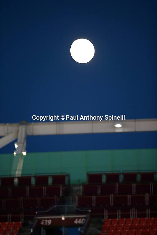 A full moon rises above the stadium before the Washington Redskins NFL week 5 regular season football game against the Seattle Seahawks on Monday, Oct. 6, 2014 in Landover, Md. The Seahawks won the game 27-17. ©Paul Anthony Spinelli