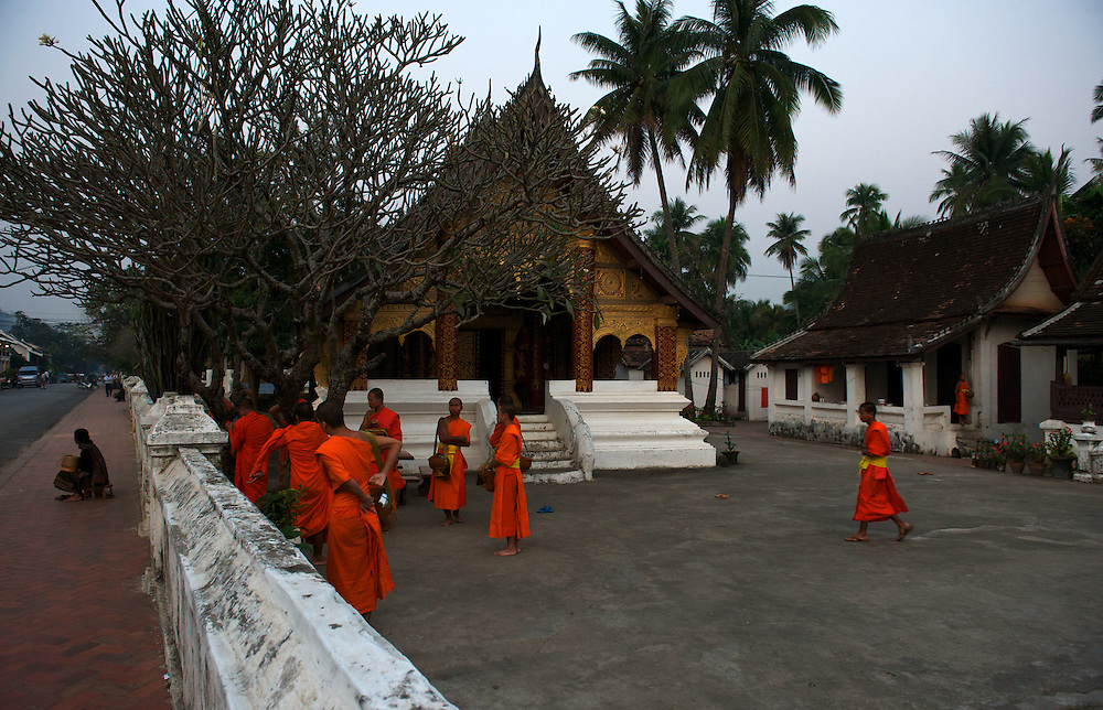 Each dawn Novice monks file around a temple circuit in Laos' old Royal Capital Luang Prabang, on the banks of the Mekong River, to collect alms from the town's residents and vistors, Laos