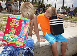 August 21, 2017 - Florida, U.S. - THOMAS ASKARI, 7, and SEAN ASKARI, 10, Wellington view with their homemade viewers at total solar eclipse at Dubois Park. (Credit Image: © Melanie Bell/The Palm Beach Post via ZUMA Wire)