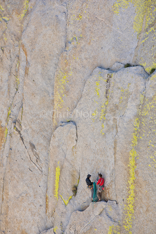 "Conrad Anker & Peter Croft at a belay ledge on ""Atlantis"" (11+), on ""The Sorcerer,"" in The Needles of California."