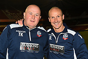 Bolton's coach Tony Kelly (L) and head coach David Lee during the U23 Professional Development League Play-Off Final match between Nottingham Forest and Bolton Wanderers at the City Ground, Nottingham, England on 4 May 2018. Picture by Jon Hobley.