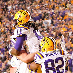 November 17, 2012; Baton Rouge, LA, USA;  LSU Tigers running back Spencer Ware (11) celebrates with teammates after scoring on a two-point conversion to tie the game in the fourth quarter against the Ole Miss Rebels in a game at Tiger Stadium. LSU defeated Ole Miss 41-35. Mandatory Credit: Derick E. Hingle-US PRESSWIRE