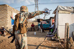 JOHANNESBURG, April 21, 2020  A soldier of South African National Defense Force reminds locals not to stay outdoor in Johannesburg, South Africa, April 20, 2020..  South Africa's COVID-19 cases have surged to 3,300, up by 142 from the previous count, Health Minister Zweli Mkhize said Monday. (Photo by Yeshiel/Xinhua) (Credit Image: © Xinhua via ZUMA Wire)