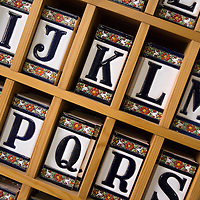 Detail of tile letters in a ceramics shop in Triana, 'Ceramica Santa Ana,' San Jorge 31, +954-33-39-90.  Seville, Andalusia, Spain, Europe.