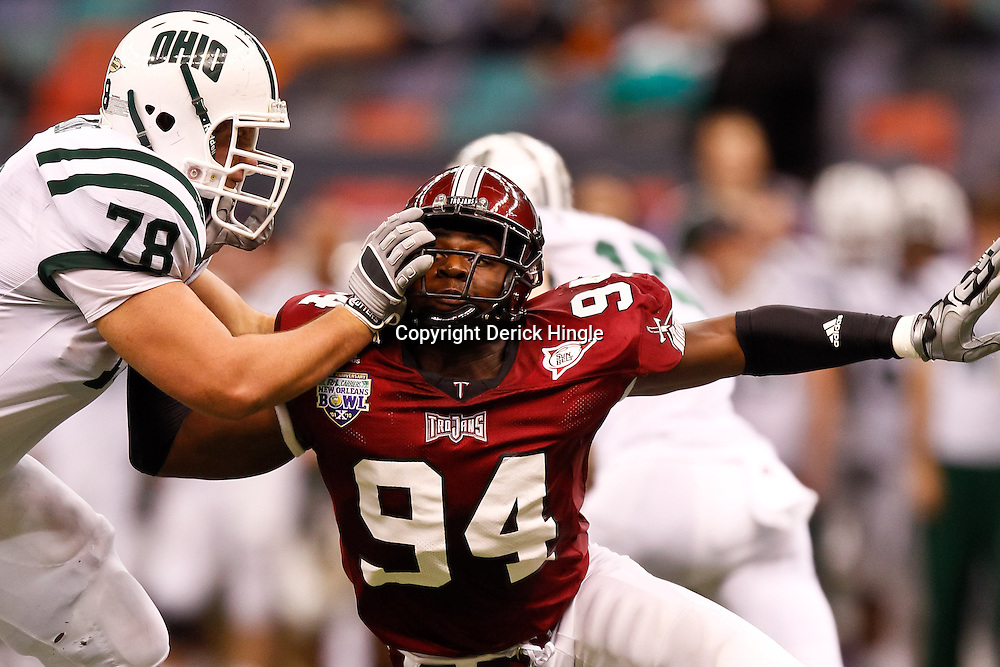 December 18, 2010; New Orleans, LA, USA; Ohio Bobcats offensive linesman Joe Flading (78) blocks against Troy Trojans defensive end Jonathan Massaquoi (94) during the first half of the 2010 New Orleans Bowl at the Louisiana Superdome.  Mandatory Credit: Derick E. Hingle