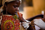 A girl gets vaccinated against meningitis at a MSF vaccination site in Tibiri, Niger on Friday April 17, 2009.