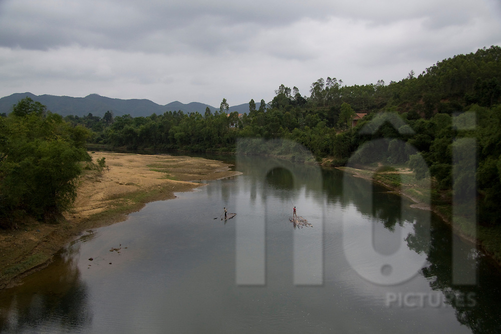 Men crossing a river on rudimentary rafts in Cao Bang area, Vietnam, Asia