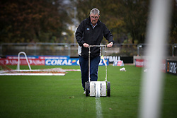 © Licensed to London News Pictures . 06/11/2015 . Salford , UK . GERARD CARTER , Salford City FC Vice Chairman and volunteer , painting fresh lines on the pitch . TV crews and volunteers at the club set up for the FA Cup match between Salford City FC and visitors Notts County , at the club's Moor Lane ground . Photo credit : Joel Goodman/LNP