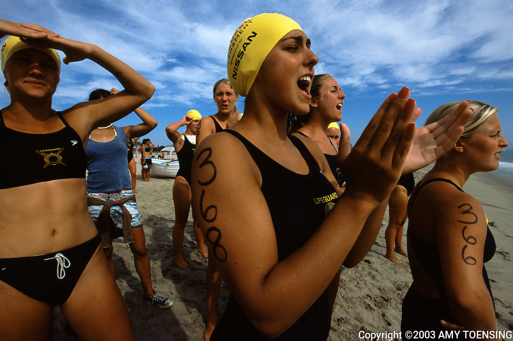 SANDY HOOK, NJ - JULY 30: Women cheer on their teammates at the National Women's Lifeguard Tournament July 30, 2003 in Sandy Hook, New Jersey. The Jersey Shore, a 127 mile stretch of coastline known for its variety of beaches, boardwalks, small towns, natural beauty and summer crowds, has been a popular summer destination for over a century. (Photo By Amy Toensing)