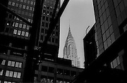 """Chrysler Building seen through buildings and scaffolding near Grand Central Station...Part of long-term (2005-2008) story """"I See A Darkness"""". New York, NY."""