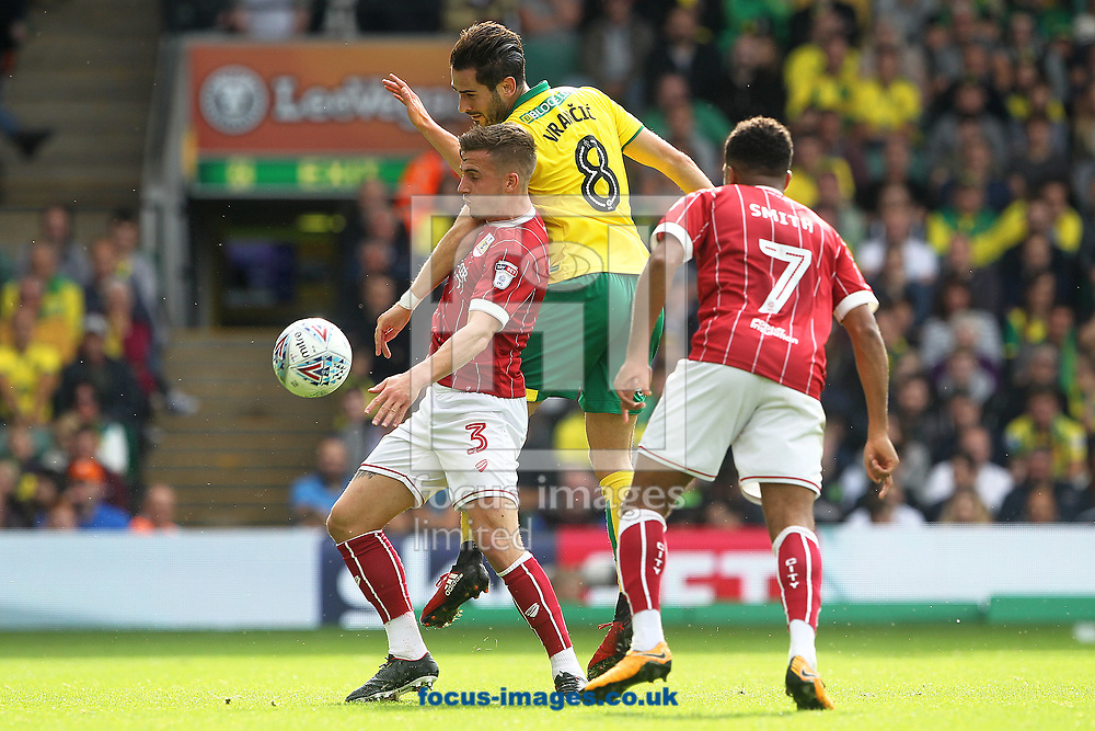 Mario Vrancic of Norwich and Joe Bryan of Bristol City in action during the Sky Bet Championship match at Carrow Road, Norwich<br /> Picture by Paul Chesterton/Focus Images Ltd +44 7904 640267<br /> 23/09/2017