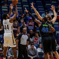 Mar 20, 2018; New Orleans, LA, USA; New Orleans Pelicans forward Solomon Hill (44) shoots over Dallas Mavericks forward Harrison Barnes (40) and center Dirk Nowitzki (41) during the first quarter at the Smoothie King Center. Mandatory Credit: Derick E. Hingle-USA TODAY Sports