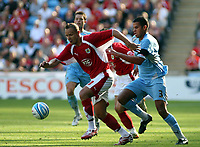 Photo: Mark Stephenson.<br /> Coventry City v Bristol City. Coca Cola Championship. 15/09/2007.Bristol's Lee Trundale gets the better of Marcus Hall