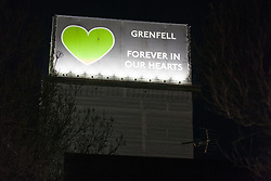 London, UK. 14th February, 2019. Members of the Grenfell community and firefighters take part in the Grenfell Silent Walk around North Kensington on the monthly anniversary of the fire on 14th June 2017. 72 people died in the Grenfell Tower fire and over 70 were injured.