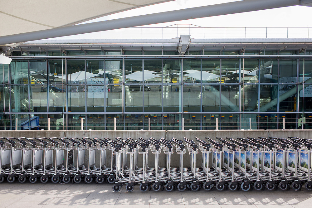 Luggage trolleys outside departures of terminal 5 at Heathrow Airport, London, United Kingdom.  (photo by Andrew Aitchison / In pictures via Getty Images)