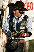 """061308-Evergreen, CO-fridaynightbulls-Bull rider Clayton Savage walks to the chutes after scoring a 77 point ride during the """"Friday Night Bulls"""" competition Friday, June 13, 2008 at the Evergreen Rodeo Grounds..Photo By Matthew Jonas/Evergreen Newspapers/Photo Editor"""