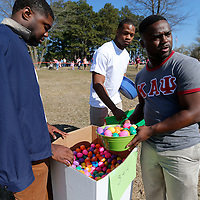 Thomas Wells | BUY at PHOTOS.DJOURNAL.COM<br /> Brandon Bagwell, from left, Terry Caldwell and Justin Hurd volunteer from University of Mississippi to help with thsi year's Easter Egg Hunt at Ballard Park on Saturday.