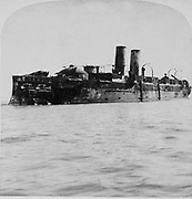 The Spanish 'Vizcaya'--destroyed by American fleet--on the rocks off Cuba. photographic print on stereo card : stereograph. c1899. Spanish-American war