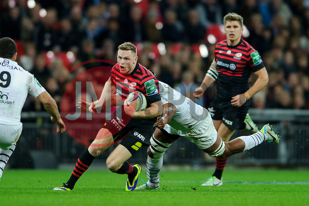 Saracens Winger (#14) Chris Ashton is tackled by Toulouse Flanker (#7) Thierry Dusautoir during the first half of the match - Photo mandatory by-line: Rogan Thomson/JMP - Tel: 07966 386802 - 18/10/2013 - SPORT - RUGBY UNION - Wembley Stadium, London - Saracens v Toulouse - Heineken Cup Round 2.