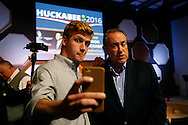 Drake student Ben Verhasselt of Des Moines (left) records a Snapchat video with Republican presidential candidate Mike Huckabee Tuesday, Oct. 6, 2015, during the former Arkansas governor's speech to homeschool families at Lifehouse Community Church in Urbandale. Verhasselt said he planned to add Huckabee's 10-second pitch to the Iowa snap story.