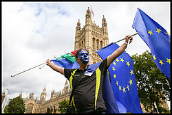 September 11, 2017 - London, London, United Kingdom - Image ©Licensed to i-Images Picture Agency. 11/09/2017. London, United Kingdom. Pro-EU campaigner in Westminster. A pro-EU campaigner with European Union Flags and a face mask outside Houses of Commons. Picture by Dinendra Haria / i-Images (Credit Image: © Dinendra Haria/i-Images via ZUMA Press)