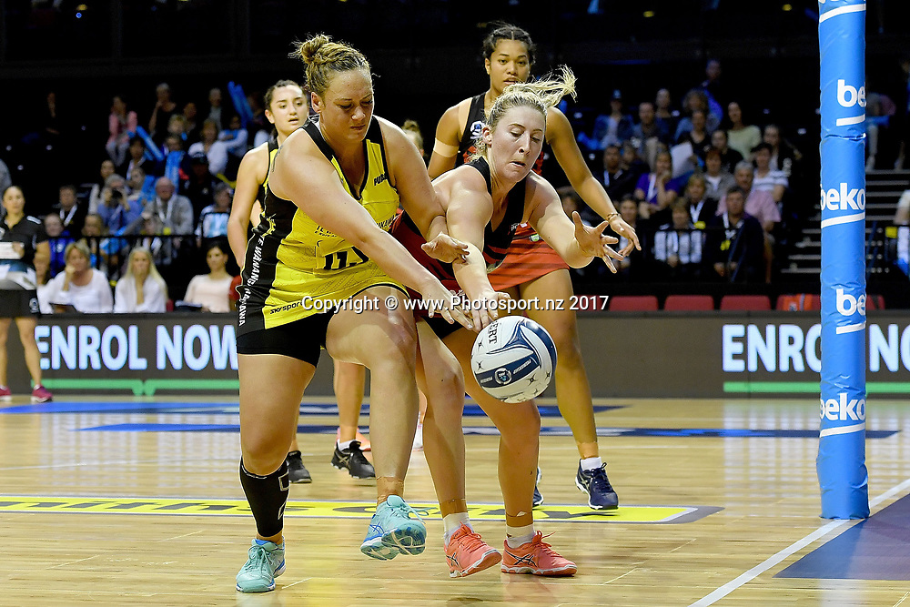 Pulse's Catherine Tuivaiti (L) dives for the ball with Tactix's Zoe Walker during the ANZ Premiership netball match between the Wellington Pulse vs Mainland Tactix at TSB Arena in Wellington on Sunday the 9th of April 2017. Copyright Photo by Marty Melville / www.Photosport.nz