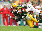 GREEN BAY, WI - SEPTEMBER 25:  Quarterback Brett Favre #4 of the Green Bay Packers tackles cornerback Ronde Barber #20 of the Tampa Bay Buccaneers after Barber recovered a fumble at Lambeau Field on September 25, 2005 in Green Bay, Wisconsin. The Buccaneers defeated the Packers 17-16. ©Paul Anthony Spinelli *** Local Caption *** Brett Favre;Ronde Barber