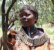 Africa, Ethiopia, Debub Omo Zone, Tsamai tribesmen. (Also Tsemai) An agricultural and cattle herder ethnic group located in Southwestern Ethiopia, Woman wearing traditional leather clothing and shell necklace