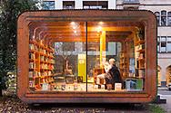Europe, Germany, Cologne, Germany's first kiosk for books called minibib at the Stadtgarten, at the &quot;minibib&quot; people can  lend books for free. No personal datas will be recorded, no library card is needed. It is an instrument by the municipal library to promoting literacy.<br /> <br /> Europa, Deutschland, Koeln, Deutschlands erstes Buecherbuedchen minibib im Stadtgarten, bei der &quot;minibib&quot; handelt es sich um ein neues Instrument zur Lesefoerderung der Stadtbibliothek Koeln, das deutschlandweit einzigartig ist.  Es werden kostenlos Buecher verliehen, die nach spaetesten zwei Wochen zurueckgegeben werden muessen. Dazu werden weder Personalien erfasst noch ein Ausweis zur Ausleihe ausgestellt.