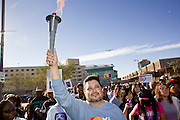 19 JANUARY 2009 -- PHOENIX, AZ: Phoenix City Councilman MICHAEL NOWAKOWSKI carries a torch during the Phoenix Martin Luther King Jr Day march. About 500 people marched three miles through Phoenix, Monday Jan. 19, in memory of Dr. Martin Luther King Jr. This year the march also marked Jan 20 inauguration of Barack Obama as the US President.   PHOTO BY JACK KURTZ