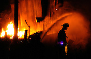 Firefighters from E.M. Holt and Mt. Hope fire departments <br /> battle a blaze at 3221 Porter Sharpe Road in Alamance, N.C. Tuesday, November 13, 2012. The thirty-year-old building which housed a private welding shop was a total loss.