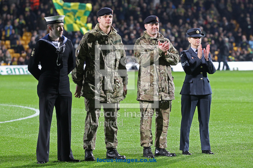 Picture by Paul Chesterton/Focus Images Ltd +44 7904 640267<br /> 09/11/2013<br /> Members of the armed forces past and present including a 94 year old veteran, both sets of fans and the players and officials from both teams observe a one minutes silence before the Barclays Premier League match at Carrow Road, Norwich.