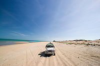 Car tracks on a remote beach on the west coast of Cape York in far northern Australia mark where volunteer ecotourists monitor the nesting sites of rare turtles.