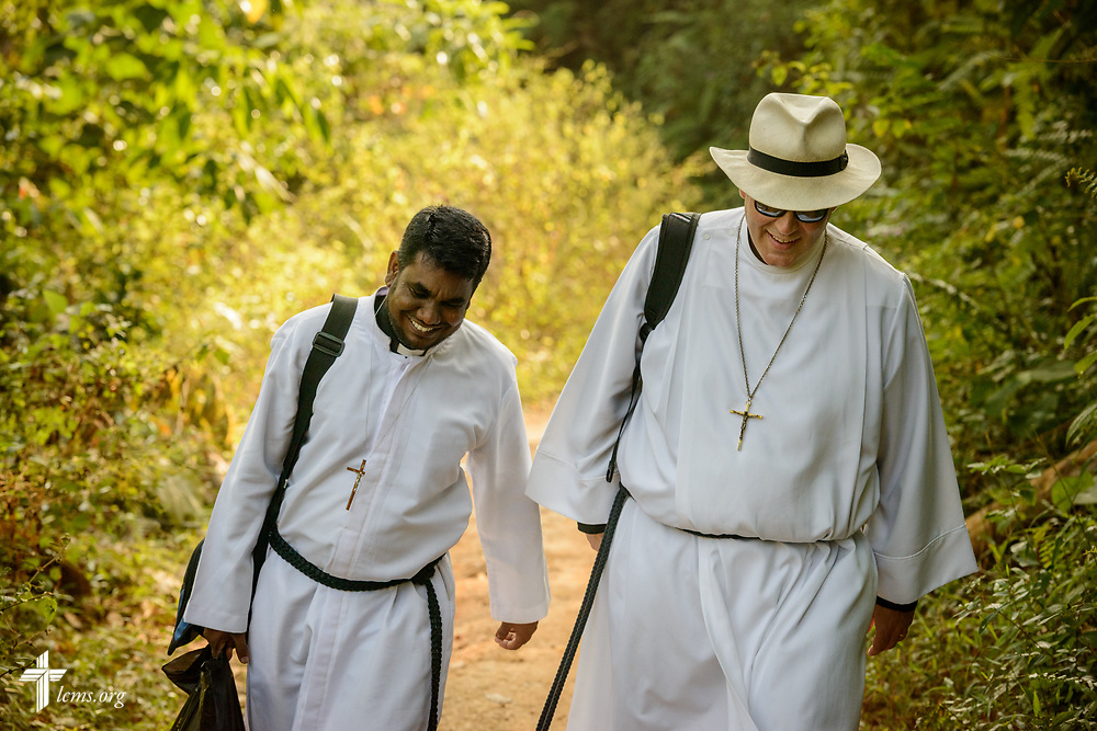 The Rev. Steven Mahlburg, LCMS career missionary to Sri Lanka, and the Rev. P. Gnanakumar, walk to the Eila rubber plantation for worship in the Sabaragamuwa Province of Sri Lanka on Sunday, Jan. 21, 2018. LCMS Communications/ Erik M. Lunsford
